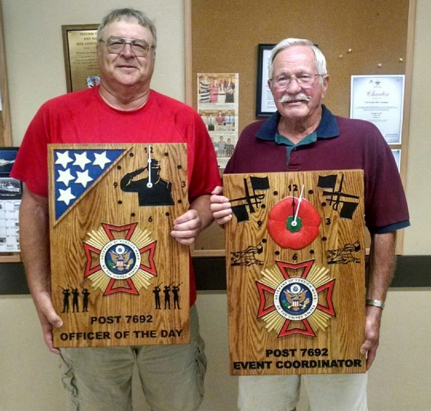 Commander Dennis Techlin presented awards to Denny Peters, Officer of the Day and Clyde Baumgart, Event Coordinator for outstanding service to VFW Freedom Post 7692.  The presentations were made during the annual Post cook out July 21, 2016.